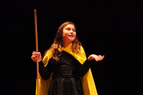 A child performing a play