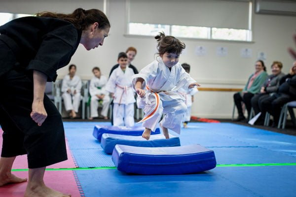 Young girl at martial arts class