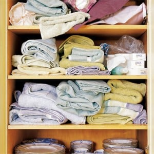 Unorganised linen cupboard
