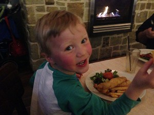 Lachlan enjoys the kids traditional fish and chips, $10