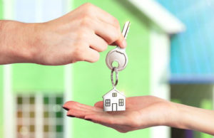 13552963 - handing over the key from a new home
