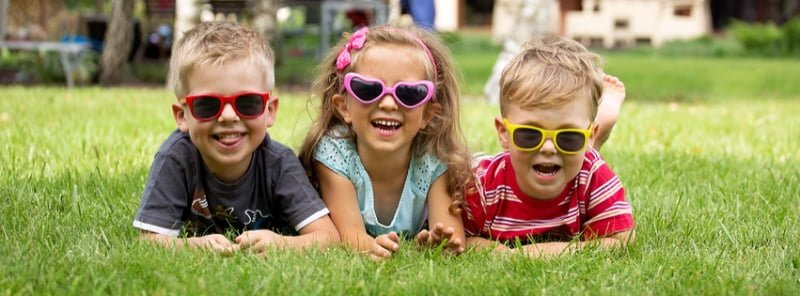 3-kids-on-grass-cover