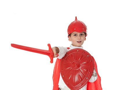 Young-Boy-Dressed-Like-a-knight-holding-a-sword-and-shield-isolated-on-white_opt