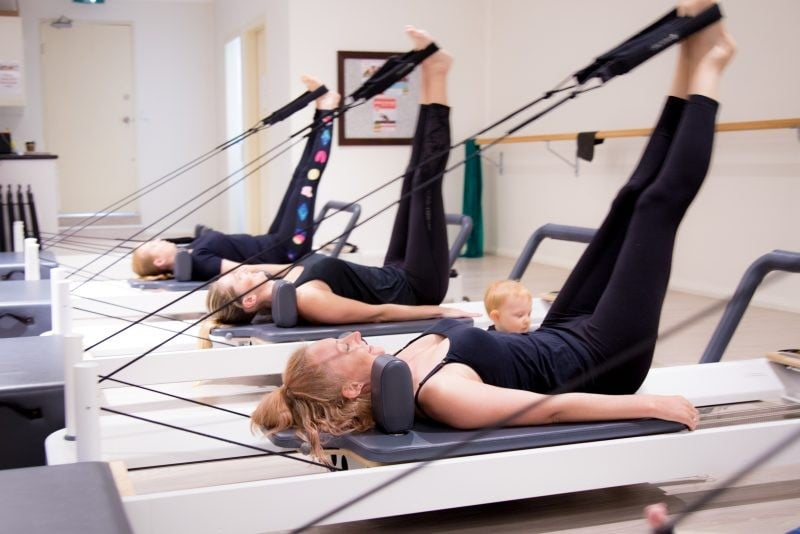 Mums-and-Bubs-Reformer.Feet-in-Straps-800x534