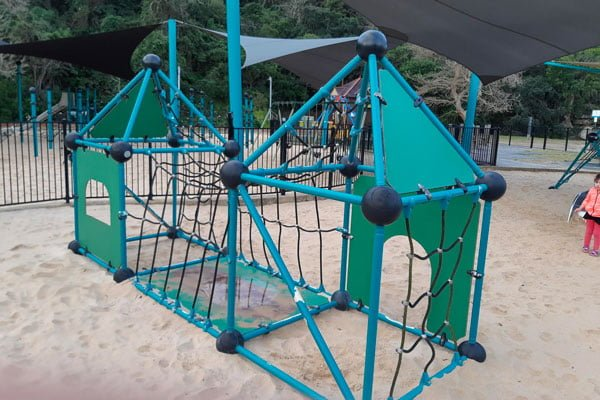 Green climbing frame in a park