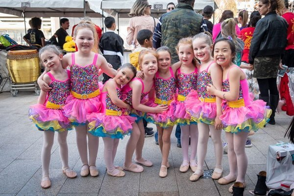 A crowd of young dancers before a show