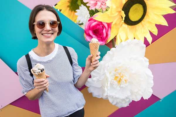 Girl holding ice cream at festival