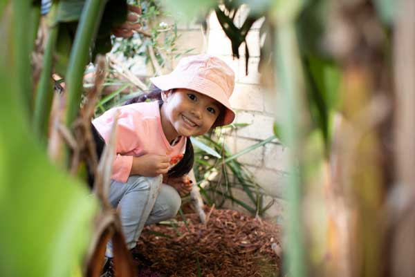 Child gardening ata daycare centre