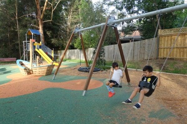 Two children swinging