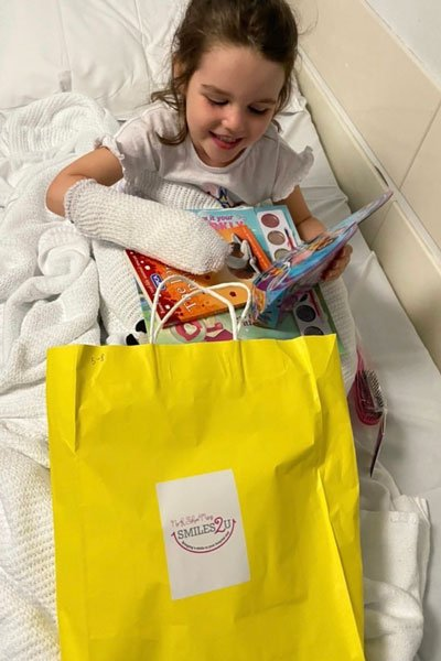 North Shore Mums Smiles2U - girl with bag