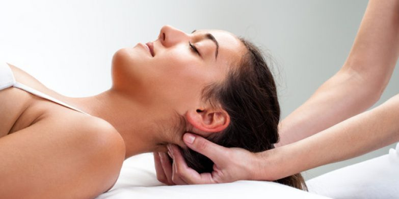 42304192 - close up of  chiropractor pressing back of womans head. therapist doing healing massage with fingers at back of neck.