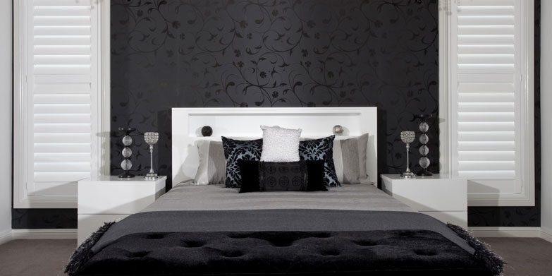 White plantation shutters bedroom