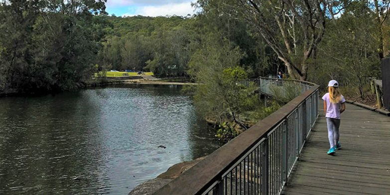 Walking across the weir to the café and playground