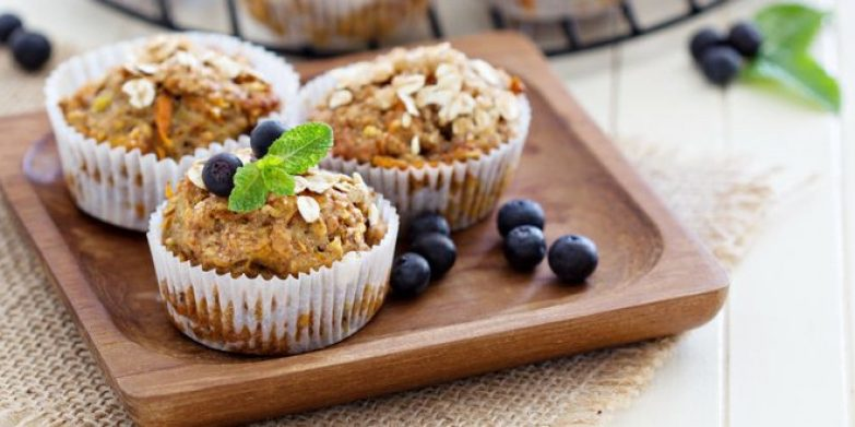 27280983 - vegan banana carrot muffins with oats and berries