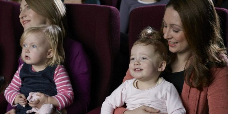 My daughter in the cinema (note the mum with pram in the front section!)