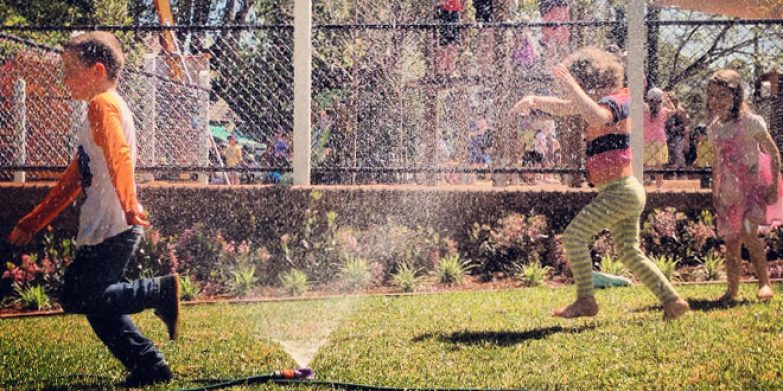 Sprinkler fun at Wahroonga Park. Image courtesy: Little Toad Photography